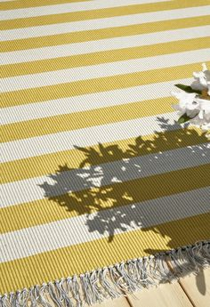 Woodnotes' In/out carpets are suited for all moist and humid conditions and for indoor use. The material is intended especially for outdoor use e.g. terrace, balcony and pool area. The Woodnotes In/out carpet has a soft feel and is transpiring therefore ideal for leisure living. Photo: In/out BIG STRIPE carpet col. yellow-light sand. Striped Carpets, In & Out, How To Clean Carpet, Balcony, Things That Bounce, Terrace, The 100, Weaving, Stripes