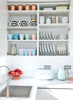 organised kitchen cupboard: mugs and plates