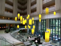 Bright yellow lights in a hotel lobby