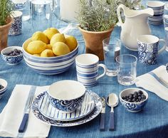 Evoking seaside living in the South of France, the Cote D'Azur blue and white tabletop collection features fresh hues and bold prints
