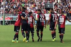 Marco Boriello of Cagliari celebrates a goal with teammates during the Serie A…