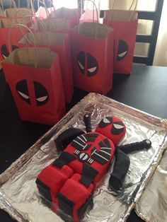 Deadpool cake and gift bags!