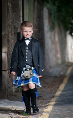 little boy in blue kilt - so adorable