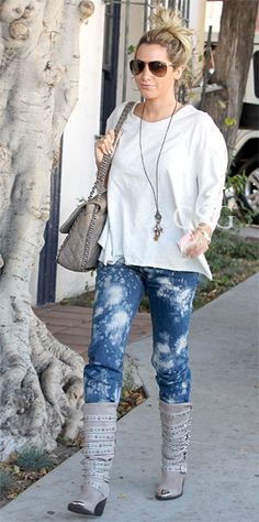 Ashley Tisdale was spotted rocking the wrap-around stud Jeffrey Campbell Kravitz Stud Boots arriving at the Nine Zero One Salon in West Hollywood Friday October 27 2012