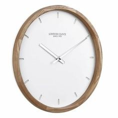 This Scandinavian inspired wall clock takes it name, 'Klokke', from the Norwegian word meaning clock. The 'Klokke' wall clock is a mix of white matte Resin & solid wood. Keeping the look minimalistic with its debossed marker dial, the 'Klokke' wall clock Big Clocks, Black Clocks, Wall Clocks, Wall Clock London, Scandinavian Design, Wall Clock Online, Design Movements, Home Decor Accessories