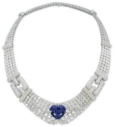 A SAPPHIRE AND DIAMOND NECKLACE, BY CARTIER - Designed as four rows of graduating diamonds to the heart shape sapphire and pave/set diamond clasps, 41 cms long, with french assay mark for gold, in red leather Cartier case. Signed Cartier, no. 610023.