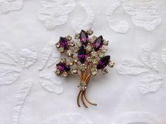 Vintage Rhinestone Brooch Diamonte. Purple and Clear Rhinestones.  by Vintage0156 on Etsy https://www.etsy.com/listing/218780930/vintage-rhinestone-brooch-diamonte