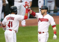 Cleveland Indians Jason Kipnis gets congrats from Carlos Santana after hitting a 2 run homer in the first inning against the Tampa Bay Rays at Progressive Field on June 22, 2016. Indians won 6-1 (Chuck Crow/The Plain Dealer)