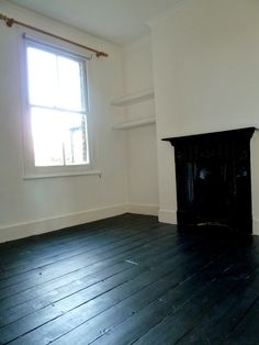 The study now monochromatic, white walls, black painted floorboards