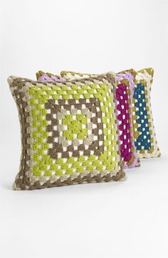 "A retro hand-crocheted pillow fluffed with a feather and down insert lends a homespun touch. Nordstrom $48        Approx. dimensions: 18"" square."