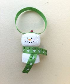 This cork ornament is made with a used wine cork and painted to look like a snowman