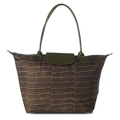 I bought this on impulse and though I love it, I think it's a bit dark. It's le pliage croco in khaki @ longchamp