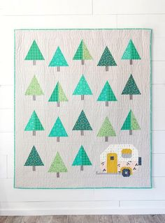 Camper/camping themed throw size quilt pattern that measures 59-1/2in x 68-3/4in