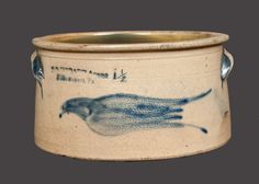 "Sold $ 2,100 Rare One-and-a-Half-Gallon Stoneware Cake Crock with Cobalt Flying Bird Decoration, Stamped ""D.P. HOBART Agent / Williamsport, Pa,"" circa 1880, short, cylindrical crock with tooled shoulder, flattened rim, and applied handles, the front decorated with a finely-brushed design of a flying bird. The decorator carved a small spot into the clay to represent the bird's eye. Excellent form and decoration with rare maker's mark. Rim chips. Light wear to both"