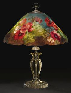 """Handel A FINE AND RARE """"POPPY"""" TABLE LAMP, MODEL NO. 7816 shade with painted mark base with firm's fabric tag reverse-painted glass and patinated metal 22 in. cm) high 18 in. cm) diameter of shade circa Painting Lamp Shades, Painting Lamps, Oil Lamps, Antique Lamps, Antique Lighting, Vintage Lamps, Chandelier Design, Chandelier Lamp, Chandeliers"""