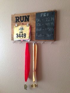 I've been browsing Etsy for some time now trying to find the perfect way to display my (few) race medals and bibs.  Up until a few days ago they have been proudly hanging from a finishing nai…