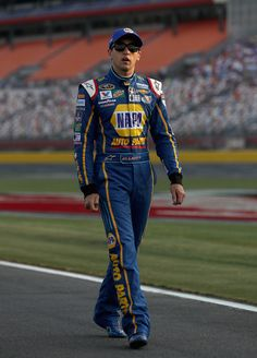 Chase Elliott Photos - Chase Elliott, driver of the #24 NAPA Auto Parts Chevrolet, walks down pit road during qualifying for the NASCAR Sprint Cup Series Coca-Cola 600 at Charlotte Motor Speedway on May 27, 2016 in Charlotte, North Carolina. - Charlotte Motor Speedway - Day 1