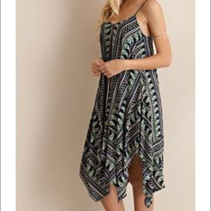 Love this dress Have this in small medium and large Paisely printed dress featuring adjustable straps and handkercheif bottom hem. Fully lined. Non-sheer. Woven. Lightweight. Very comfortable Dresses Midi