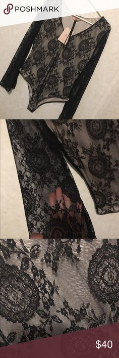 NWT lace body suit. Beautiful black lace body suit. Sheer sleeves with fully lined body and matching choker. Snaps at the crotch Tops