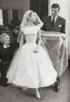 Audrey Hepburn in her tea length wedding gown