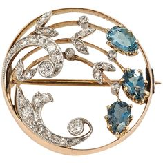 Edwardian Aquamarine Diamond Gold Circle Brooch. A good quality Edwardian period, diamond set brooch with 3 pear shaped Aquamarines mounted in platinum and 18ct yellow gold c 1900-10