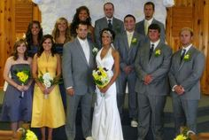 Groomsmen are in Grey suits with purple ties & yellow boutonnieres. The brides maids are in purple dresses and the maid of honor is in yellow.