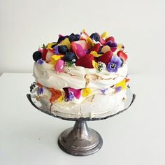 meringue cake with edible flowers and summer fruits