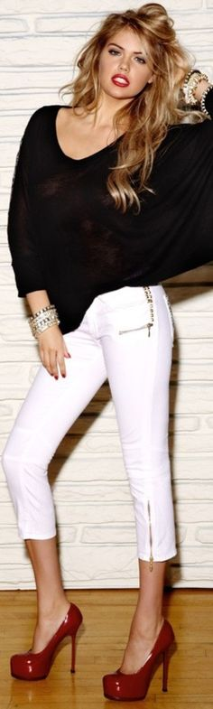 Loose black top, tight white pants, red plarform heels and red lipstick.