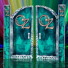 The Emerald City Grand Entrance has a green design of swirls and patterns with the words Oz on each door.