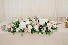 Top Table Floral Arrangement | Lucy Davenport Photography | English Country Garden Marquee Wedding | Essense Wedding Dress | Pink Multiway Bridesmaid Dresses