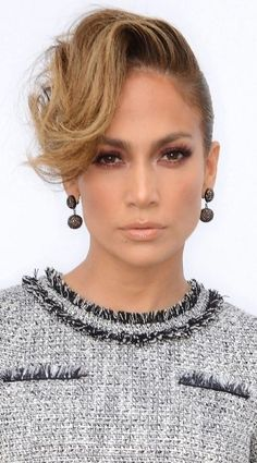 Bronzy, golden hues are universally flattering. Channel J.Lo and layer eye shadow to get the intensity you like, and be sure to add some shine to your lips.