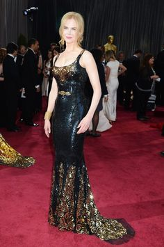 Nicole Kidman  Fred Leighton 19th Century gold and black enamel pendant earrings and 19th Century gold and diamond chain cuff bracelet