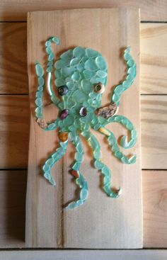 Sign of Sea Life: Octopus (kracken). Sea glass [beach glass] , natural wood background, pallet sign