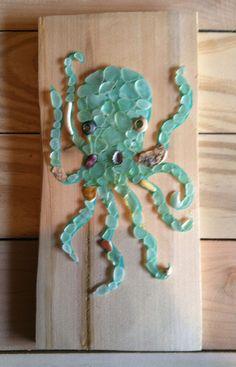 Sign of Sea Life: Octopus (kracken).  Sea glass [beach glass] , natural wood background, pallet sign