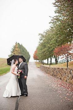 fall weddings  frederick maryland maryland photographers rainy day weddings bride and groom with umbrella
