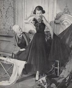 Rare photo of Madame Nina Ricci with one of her dresses on a model, 1949.