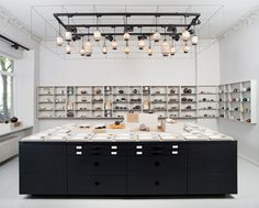 Paper & Tea store by Fabian von Ferrari, Berlin . The store's interior is a collab effort of owner Jens de Gruyter and product designer Fabian von Ferrari, and blends the aesthetics of a minimalist concept store with the atmosphere of a natural history museum.