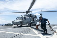 Sailor with Sea Hawk helicopter. by Official U.S. Navy Imagery, via Flickr