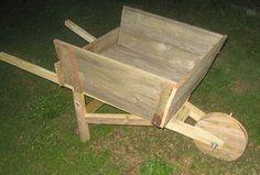 Build a wheel barrow planter box.