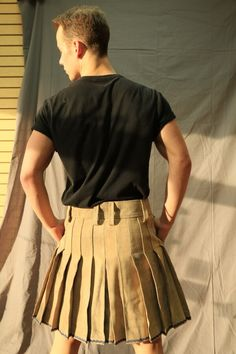 5f6da2643c This understated kilt is appropriate for any informal occasion with its  plain design and earthy colors