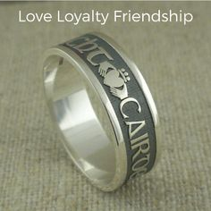 """Sterling Silver Men's 7mm Gaelic Claddagh Wedding Band made in Ireland.  Oxidized background.  Three Claddaghs with the words """"Gra, Dilseacht, Cairdeas"""" between them. Gaelic meaning Love, Loyalty & Friendship."""