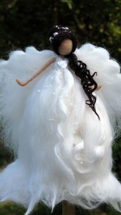 Angel Christmas tree topper decorated with pearls. Needle felted from super…
