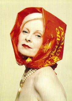 Vivienne Westwood wearing her plastic store bag as a plastic rainhood, 1994.