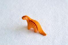 miniature dinosaur figurine - orange brontosaurus. $34.00, via Etsy.