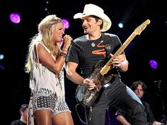"Country faves – and regular CMA Awards cohosts – Carrie Underwood and Brad Paisley get down while duetting Sunday on the final night of the CMA Music Festival in Nashville. ""Hope all you #CMAFest goers had fun this week/weekend,"""