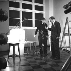 Max Dupain & Associates studio shows Kerry Dundas in ABC (ABN) OB television show 'At home with a photographer' which went to air 9 July 1958 (reporter may be Mungo McCallum), 1958.