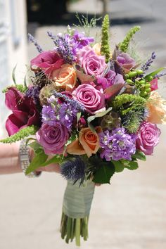 This bouquet was created for an outdoor wedding in the mountains.  Roses, callas, grasses, stock, lavender, upright amaranth & hypericum create this beautiful bouquet.