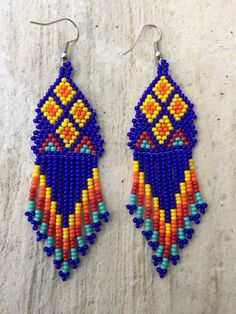 A personal favorite from my Etsy shop https://www.etsy.com/listing/271708650/huichol-beaded-earrings-3-long