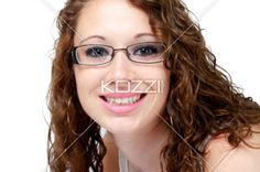 portrait of a beautiful young woman wearing spectacles. - Portrait of a beautiful young woman wearing spectacles against white background.