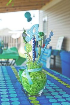 Blue and green one year birthday party #bluegreen #party. Centerpiece would be cute with the bday cutouts glued on stick. Great site with free printables too.